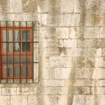 Window with bars of a medieval building